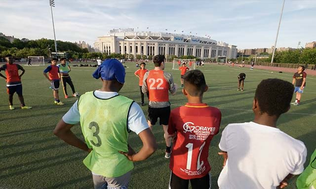 South Bronx United soccer playing practicing with Yankee Stadium in background
