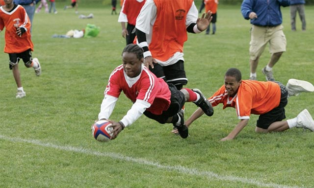 Youth ruby player for Pittsburgh Harlequins diving to score a try