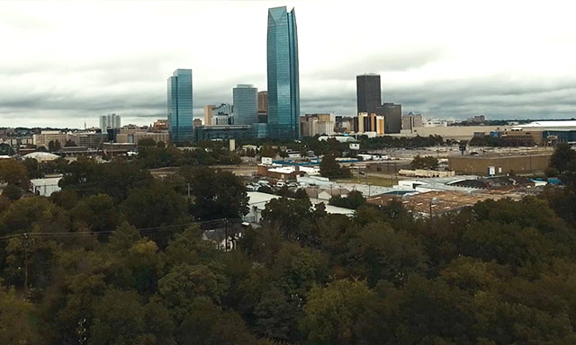 Downtown Oklahoma City skyline rising above an inner city community