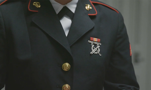 Close up of medals on Marine Corps dress blues of PFC Brianna Bighorse