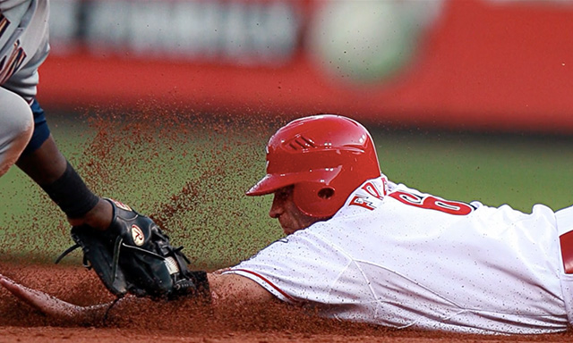 Ryan Freel sliding under a tag at second base.