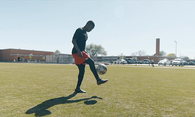 OKC Energy FC soccer player Josh Garcia juggling a soccer ball on an Oklahoma City Public Schools soccer pitch built by Fields & Futures