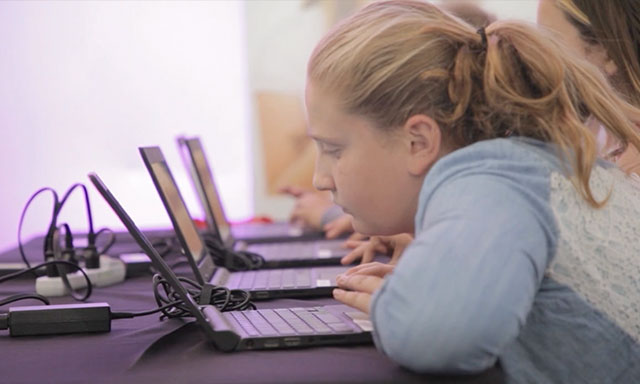 A young woman is shown attending and Indy Women in Tech event.