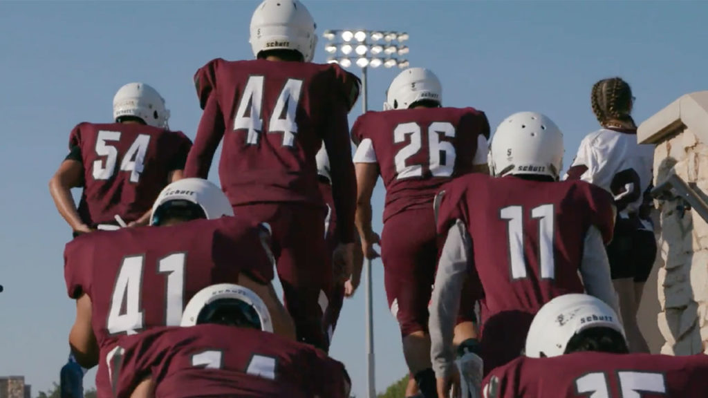 Football teammates from Santa Fe High School are shown taking the field during the Blended Brother segment during Season 3, Show 3 of Power Sports.