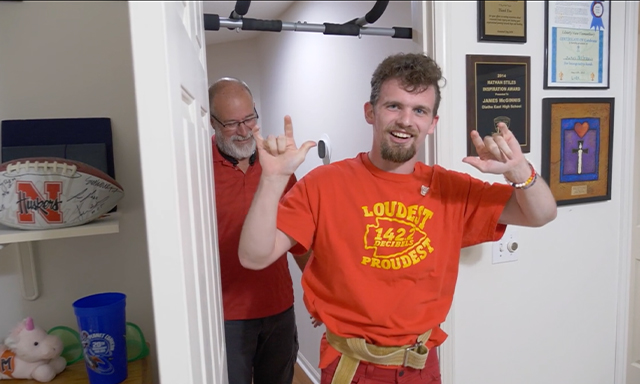 Kansas City chiefs fan James McGinnis is shown celebrating his completed chin-up challenge during Season 3, Show 3 of Power of Sports.