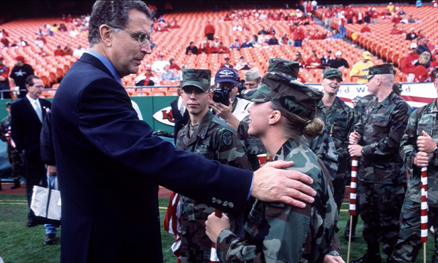 Former NFL Commissioner Paul Tagliabue is pictured greeting service members during Season 3, Show 3 of Power of Sports.