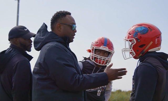 Josh Norman is seen coaching student athletes during the Coaching Against the Odds segment of Season 3, Show 3 of the Power of Sports.