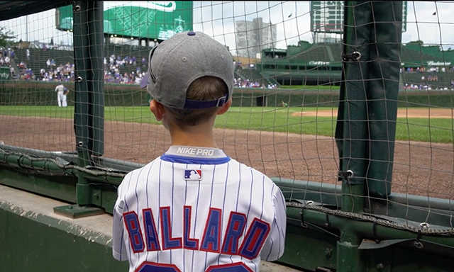 Noah Ballard is shown looking out on Wrigley Field during the Community Spotlight - Dream On 3 segment of Season 3, Show 4 of the Power of Sports.