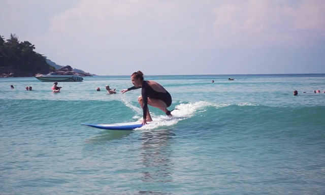 A woman seen surfing during the Power of Sports Community Spotlight – Urban Surf 4 Kids segment.