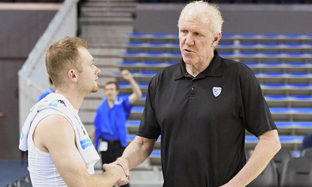 Bill Walton instructing a basketball player.