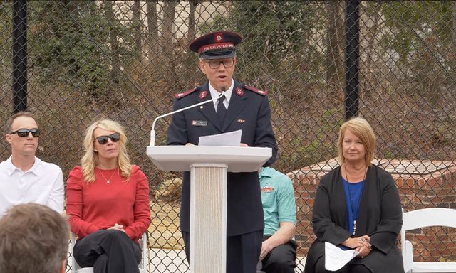 A member of the Salvation Army delivers a speech on Kevin Harvick Field in Charlotte, North Carolina.