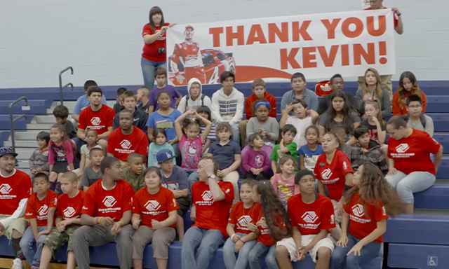 Children surround Kevin Harvick at a new facility funded by the Kevin Harvick Foundation.