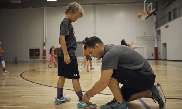 A kid gets his laces tied a sporting clinic in South Carolina.