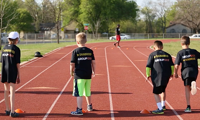 Children take off running at a track clinic hosted by Group1001.